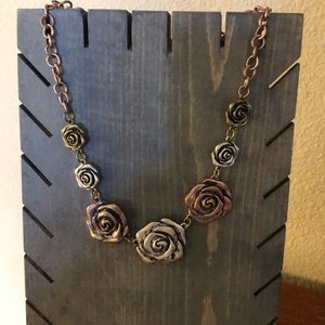Rose and silver tone flower necklace